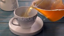 Glass Teapot Pouring Green Tea Into Cup On Wooden Table - Stock Footage | VideoHive 15647533