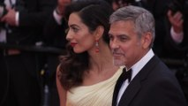 George and Amal Clooney granted restraining order