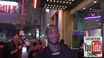 Geno Smith from New York Jets greets fans while leaving Regal LA Live Theatre in Los Angeles