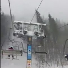 A tree falls onto a chairlift