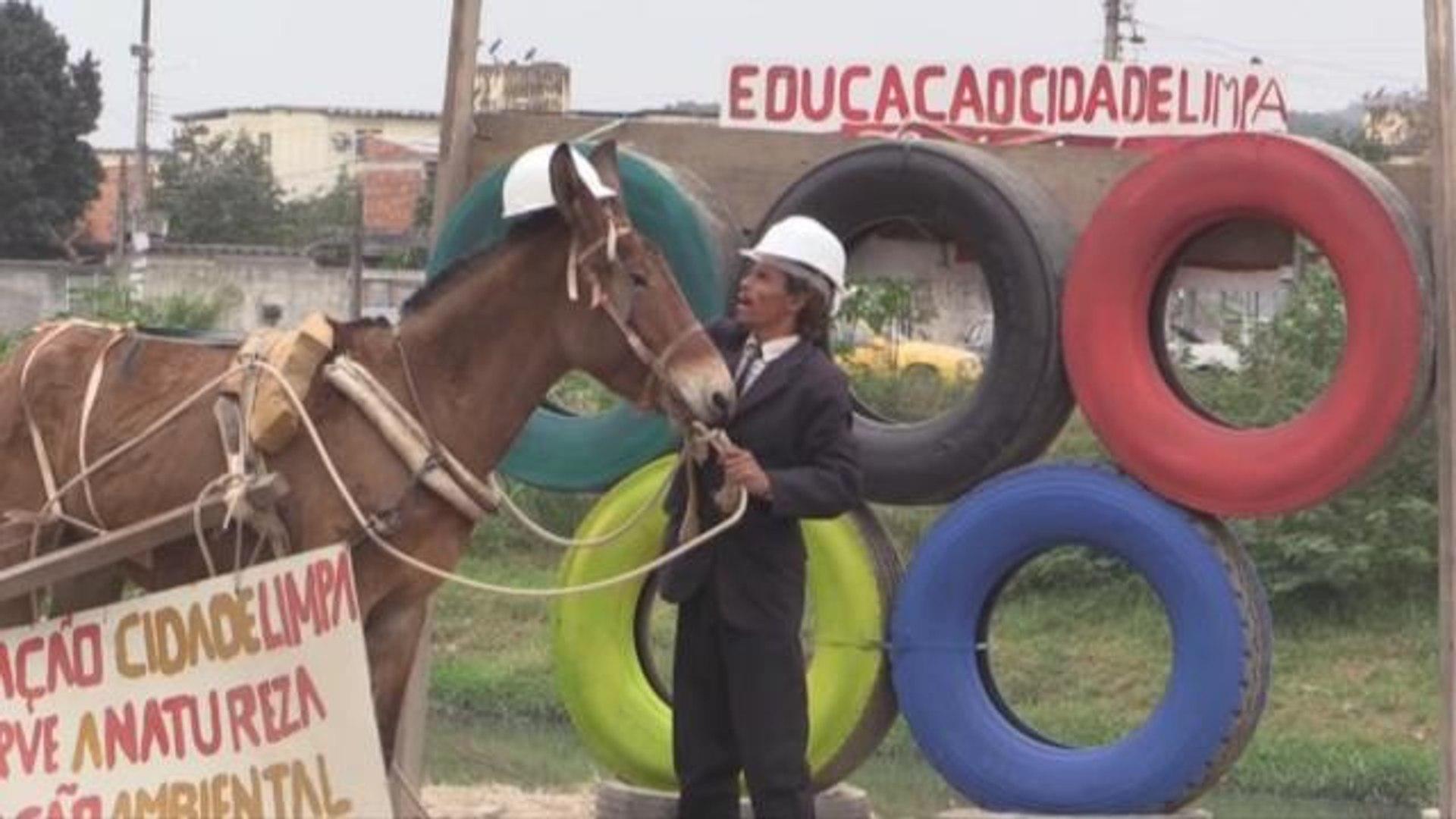 Morador monta aro olímpico de pneu para pedir investimentos em Belford Roxo