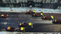 Une armée de véhicules pour refaire une route