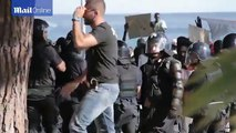 French riot police use pepper spray to prevent African migrants storming the border