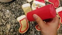 Frosting sugar cookies with royal icing