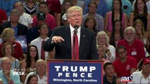 Trump criticized for offhand gun rights slap at Clinton