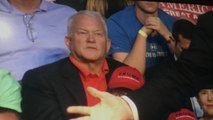 Ex-congressman Mark Foley sits behind Trump at rally