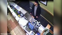 Shocking moment robber threatens till worker with meat cleaver