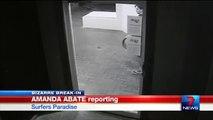 Ce voleur stupide tente d'exploser la porte vitrée d'une boutique alors que la porte est ouverte