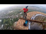 Daredevil Unicyclist Performs on Top of Giant Chimney
