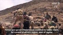 Yemen's pro-govt. forces battle rebels for oil-rich region