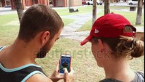 stock-footage-chandler-az-circa-july-two-millennials-play-the-popular-smartphone-game-pokemon-go-in-a
