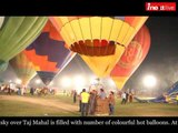 Sky over Taj Mahal filled with colourful hot balloons