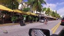 Christmas morning drive Ocean Dr. Miami Beach - People and car watching