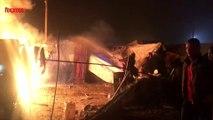 """Incendies et explosions de bonbonnes de gaz dans la """"Jungle"""" de Calais"""
