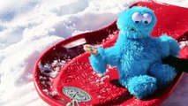 Cookie Monster Driving a Sled Crashing Falling Cookie Monster Sledding Too Icy for Cozy Coupe
