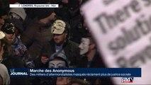 Des milliers d'altermondialistes masqués réclament plus de justice sociale
