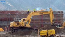 Komatsu PC220 Excavator moving dirt from pile to pile