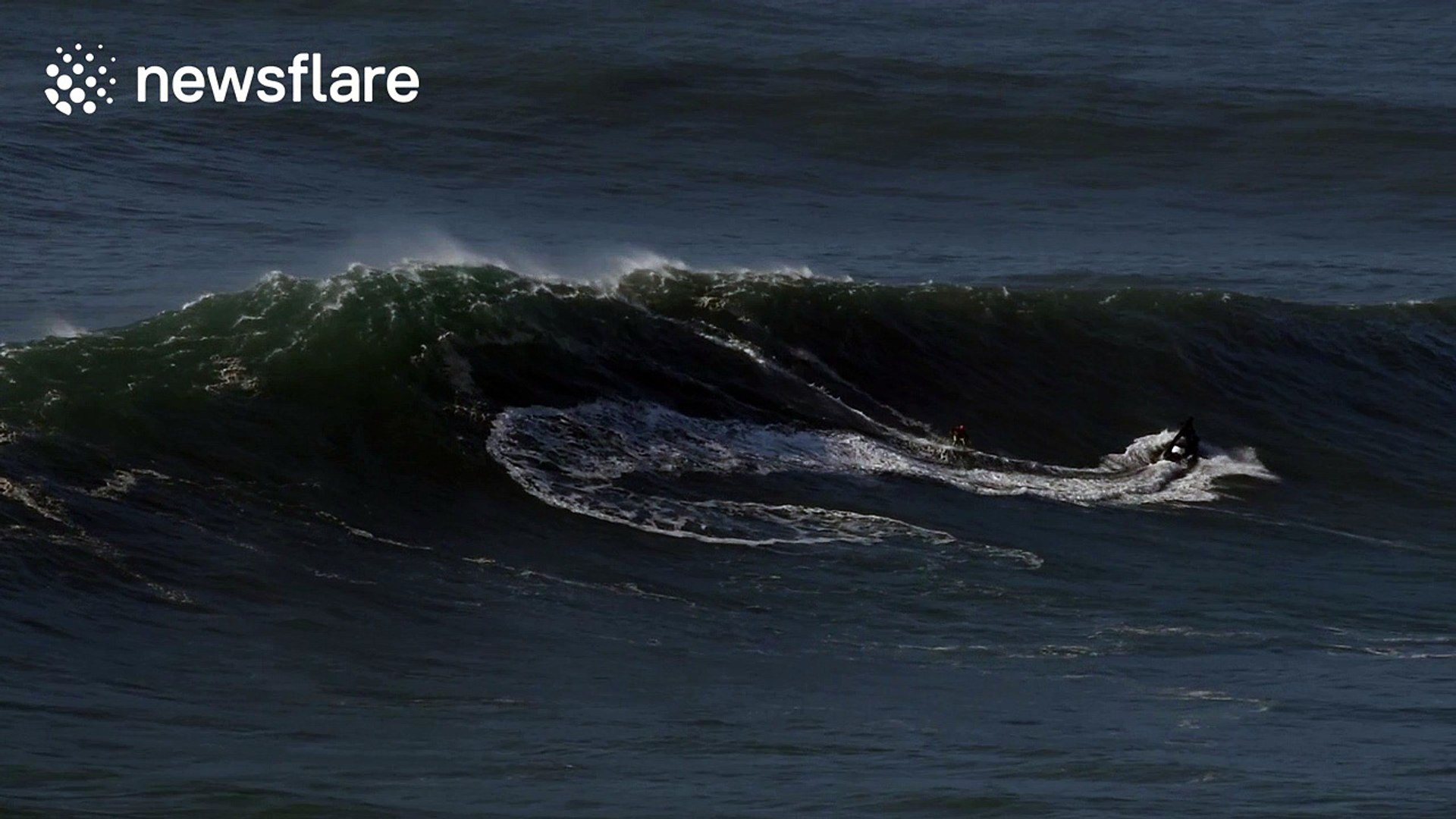 Intrepid surfers ride giant waves in Nazare, Portugal