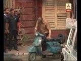 Amitabh Bachchan kickstarts a scooter while shooting in Kolkata