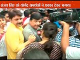 Sanjay Singh reaches to meet Yogendra at Parliament street; pushed away by his supporters