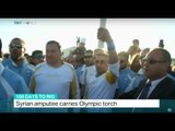 Syrian amputee carries Olympic torch