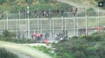 Plus d'un millier de migrants tentent de forcer la frontière Maroc-Espagne à Ceuta