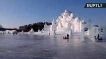 Giant Ice Castles Wow Tourists at Harbin's Ice Festival