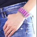 A cool bracelet made from beads and safety pins