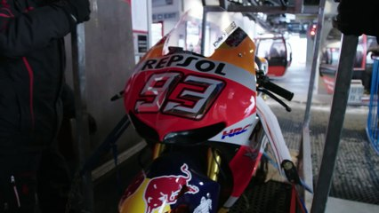 Marc Marquez rides a Honda RC213V on a downhill ski course