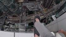 Oleg Cricket s'amuse avec son skate en haut d'un building de Hong-Kong