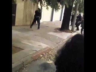 Public Execution by Firing Squad - Video Shows 10 Cops Unload on a Single Man with a Knife