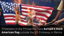 Filipinos burn mock American flag outside US Embassy