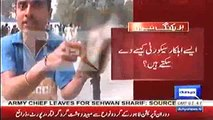 Police vehicle set on fire by protesters, enraged devotees recover bottle of wine from police vehicle in Sehwan