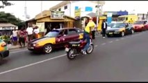 Crazy guy doing insane stunts on bike in street