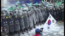 Les images de l'escalade de violence à Séoul après l'annonce de la destitution de Park Geun-Hye