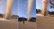 Mini tornade de poussière au milieu d'un terrain de foot