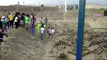 Peru floods: Woman scrambles out of devastating mudslide