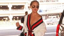 Chrissy Teigen Suffers Wardrobe Malfunction at Airport