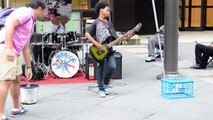 Black kid playing heavy metal music on guitar in New York