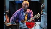 Bruce Springsteen and Chuck Berry laugh as they perform the