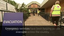 Emergency services tackle Cyclone Debbie floods
