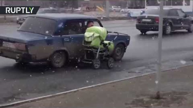 'Not nanny of the year': Man dragging pram alongside car on road