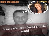 Justin Bieber gets close to Brazilian model