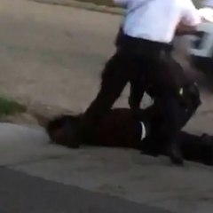 Police officer kicks man in the face