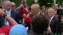 Trump signs hat, throws it back into crowd at Easter Egg Roll