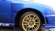 Modified Subaru Impreza STi Powersliding on Wet