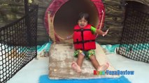 Kid playing at the WaterPark Splash Pad for children! Family Fun playtime in the Pool