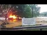 West Virginia floods : Watch burning house floating away | Oneindia News