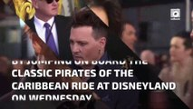 Johnny Depp climbs aboard the Pirates of the Caribbean ride at Disneyland