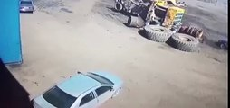 Terrifying moment tyre explodes into air and destroys car